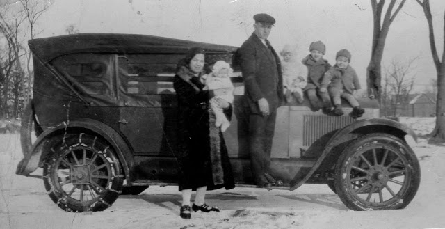 UNDER COVER...Frank and family with his ice truck, bringing bootleg liquor from Canada