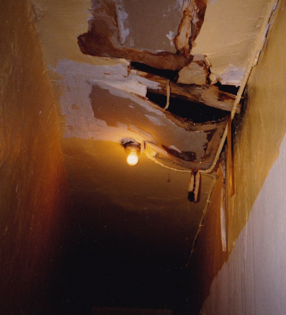 DERELICT...disintegrating hallway ceiling in Joanne's tenement in the 80s