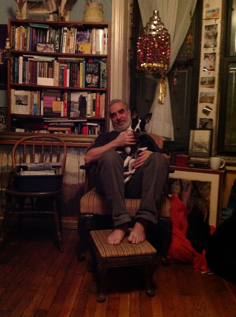 HAPPY...Seidenberg relaxes with his dog in his apartment-cum-bookshop
