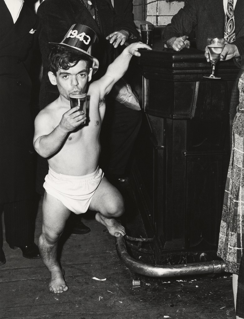 Shorty, the Bowery Cherub, New Year's Eve at Sammy's Bar, 1943. Pic by Weegee © International Center of Photography