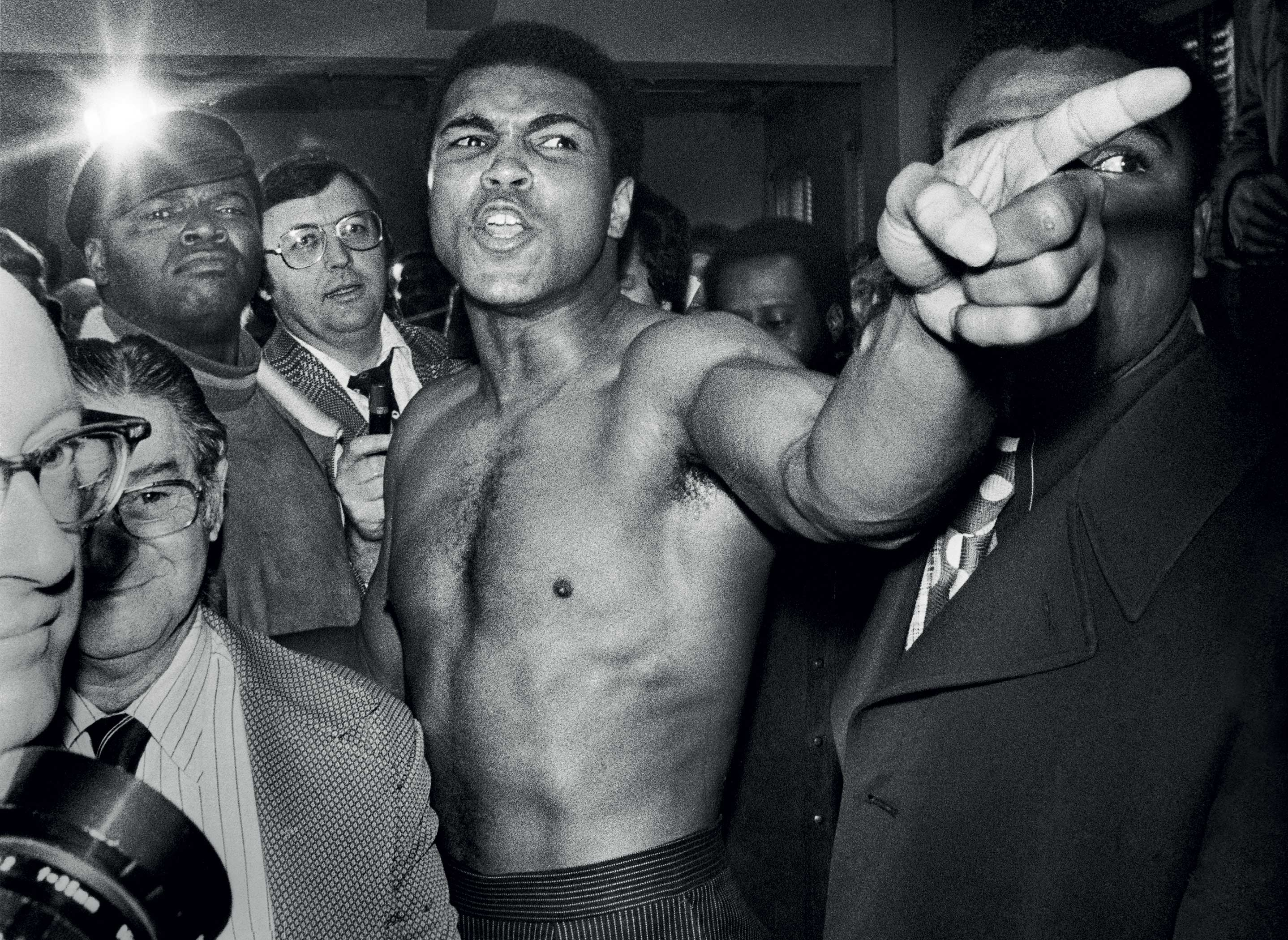 THREAT...Muhammad Ali gestures before brawling with Joe Frazier at the New York studio of ABC during the weigh-in process in 1974