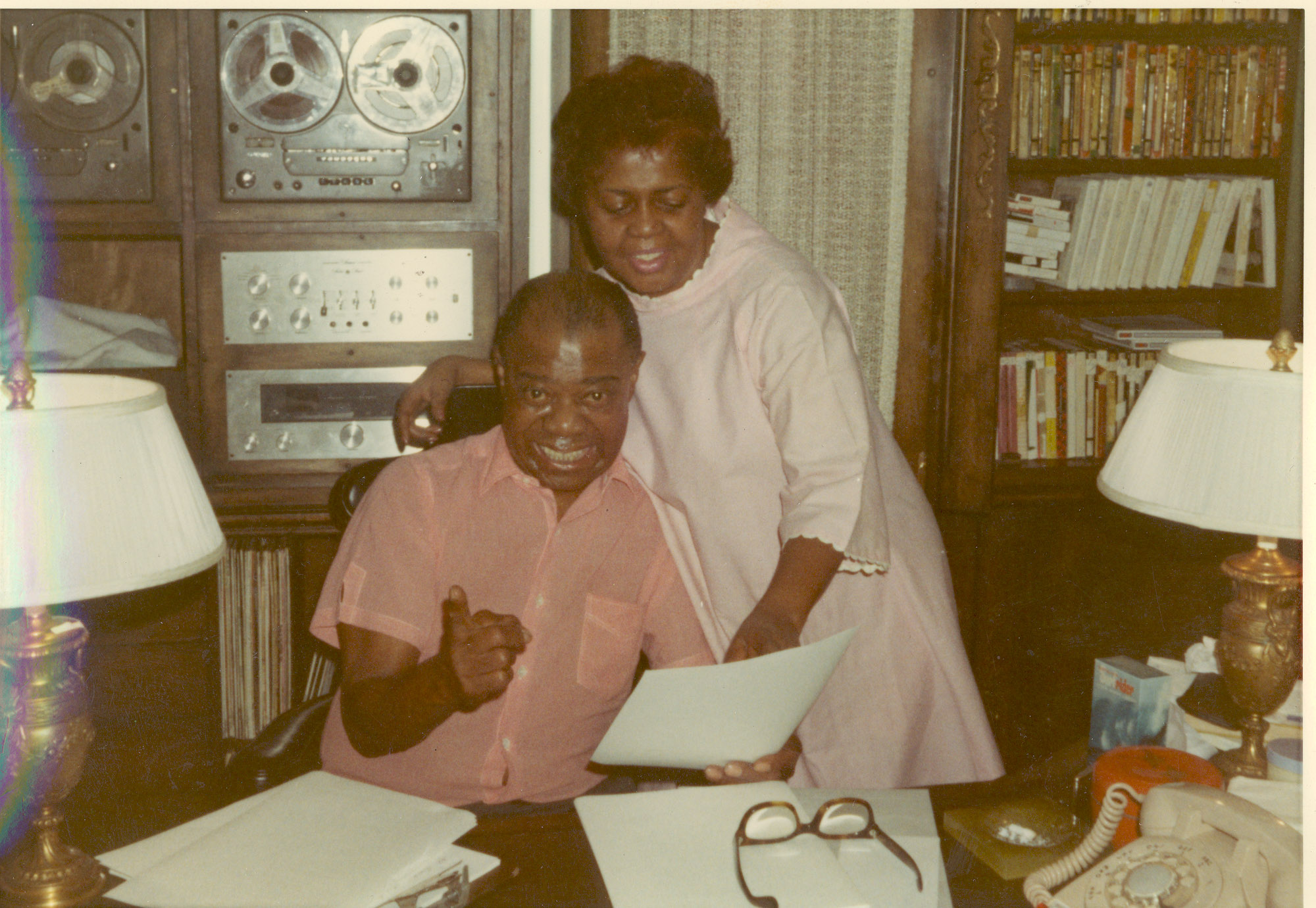 Louis and wife Lucille at his desk in the den