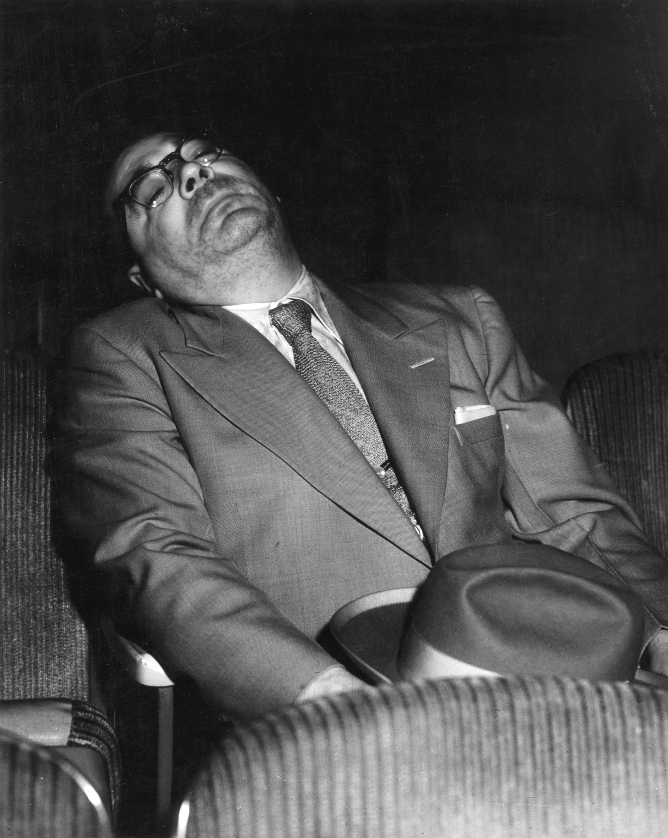DOZING: Sleeping at the Movies, ca. 1943. © Weegee/ International Center of Photography