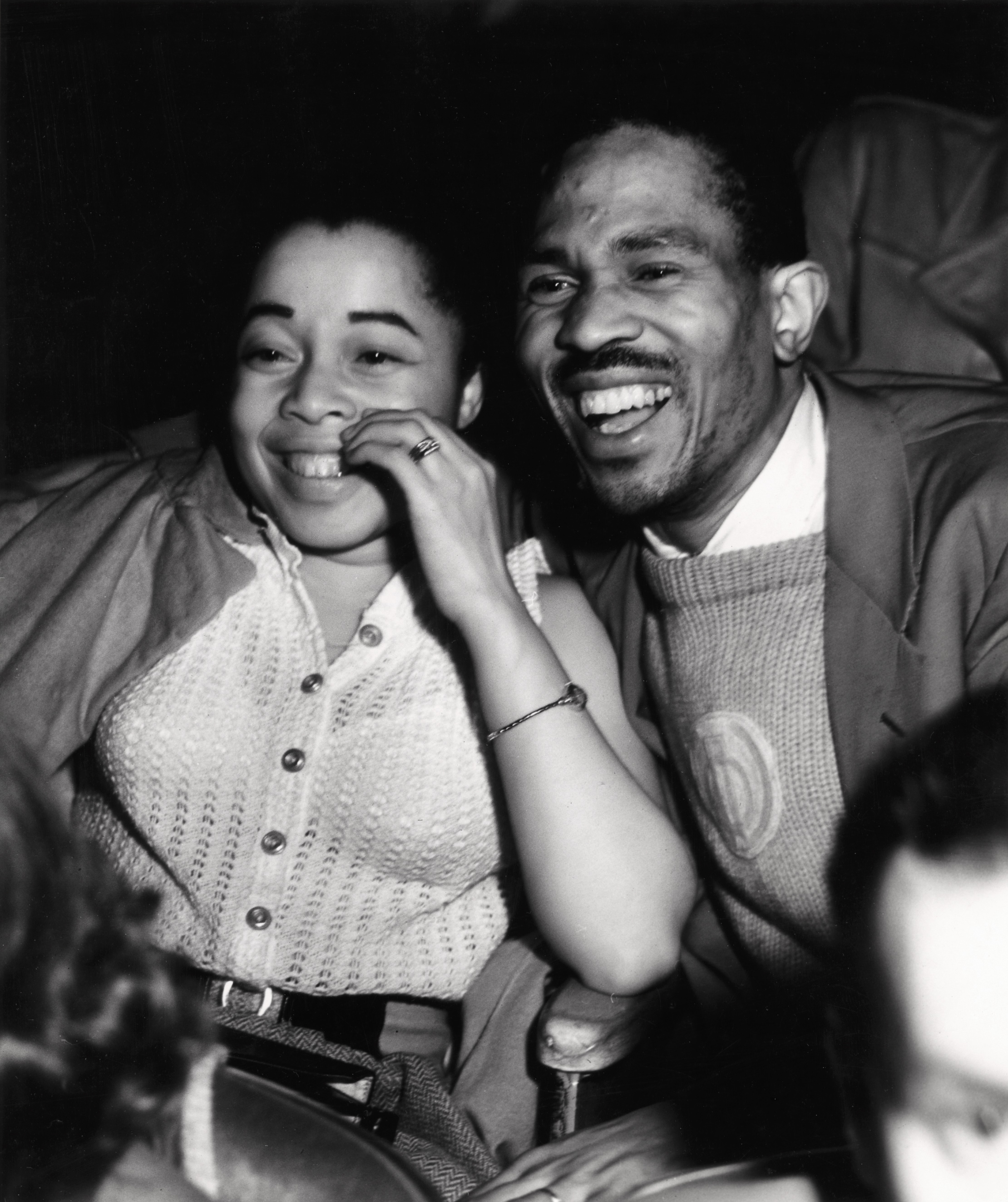 GIGGLES: Woman and man laughing  © Weegee/ International Center of Photography.