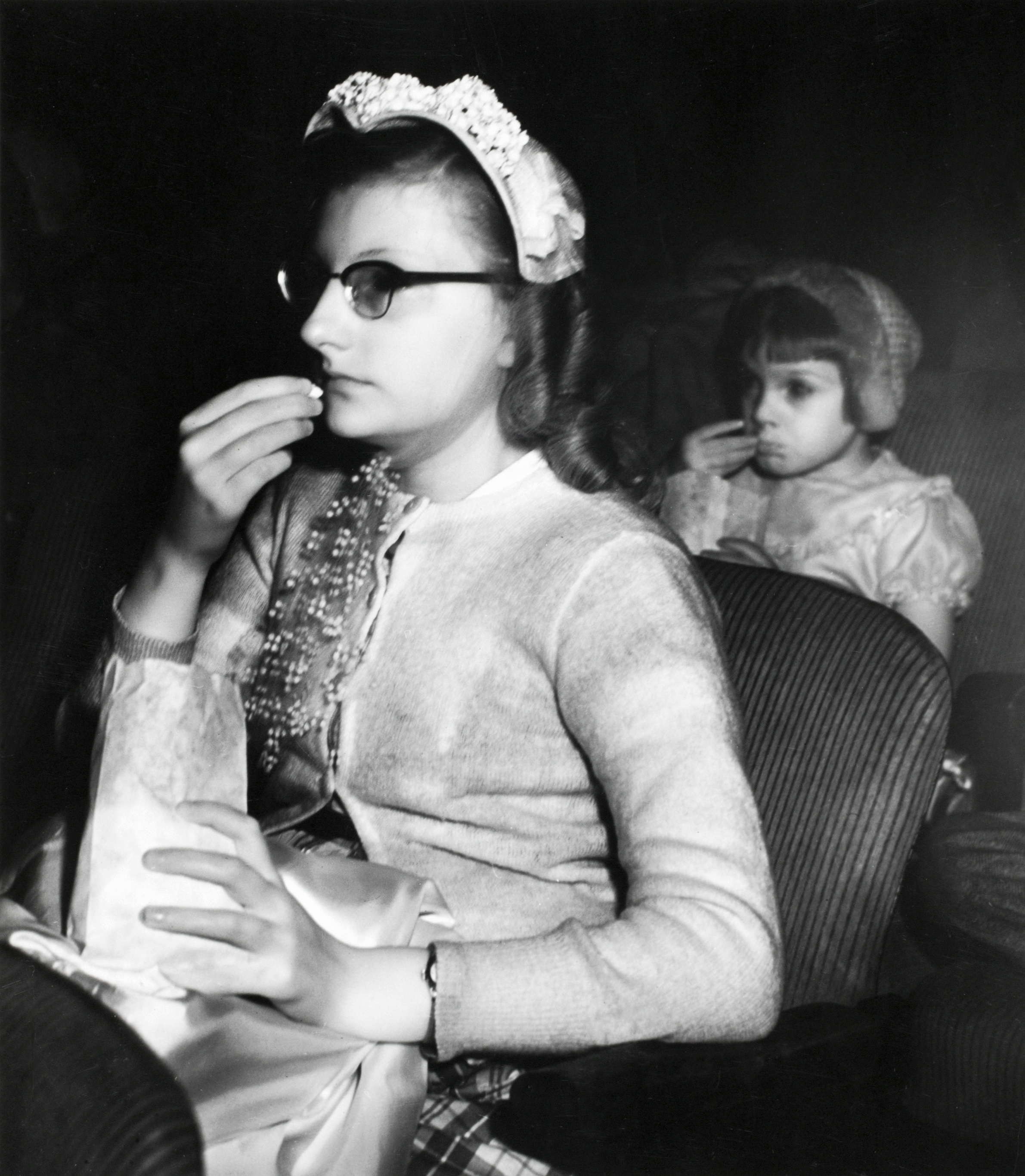TRANSFIXED: Girl eating popcorn, ca. 1943. © Weegee/ International Center of Photography.
