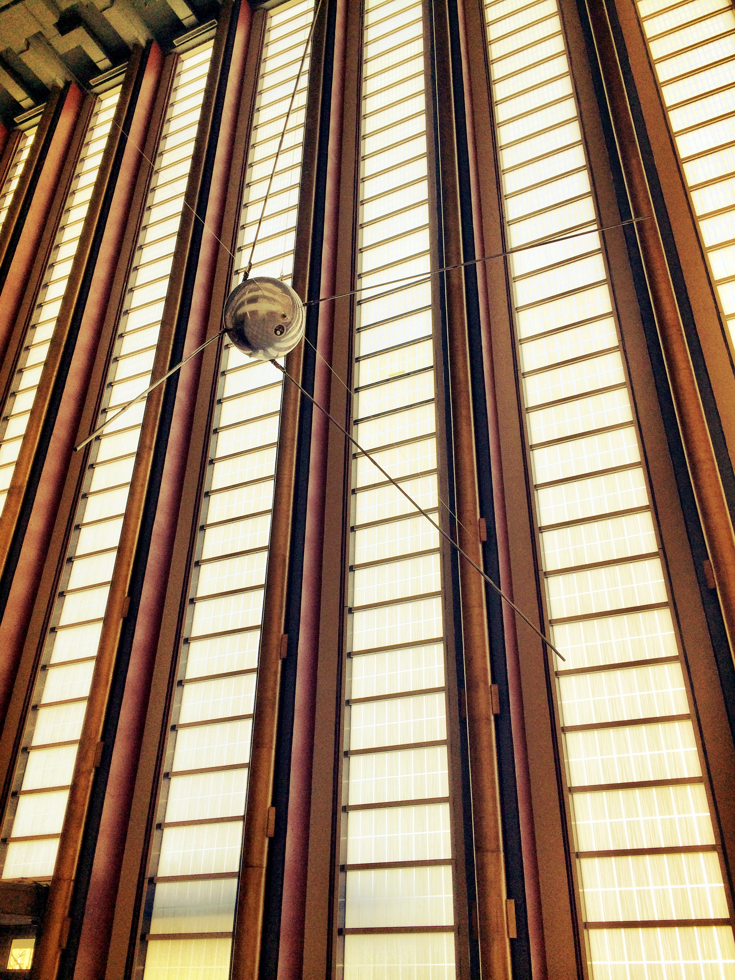 SPACE AGE...a model of Sputnik hangs by the windows of entrance lobby