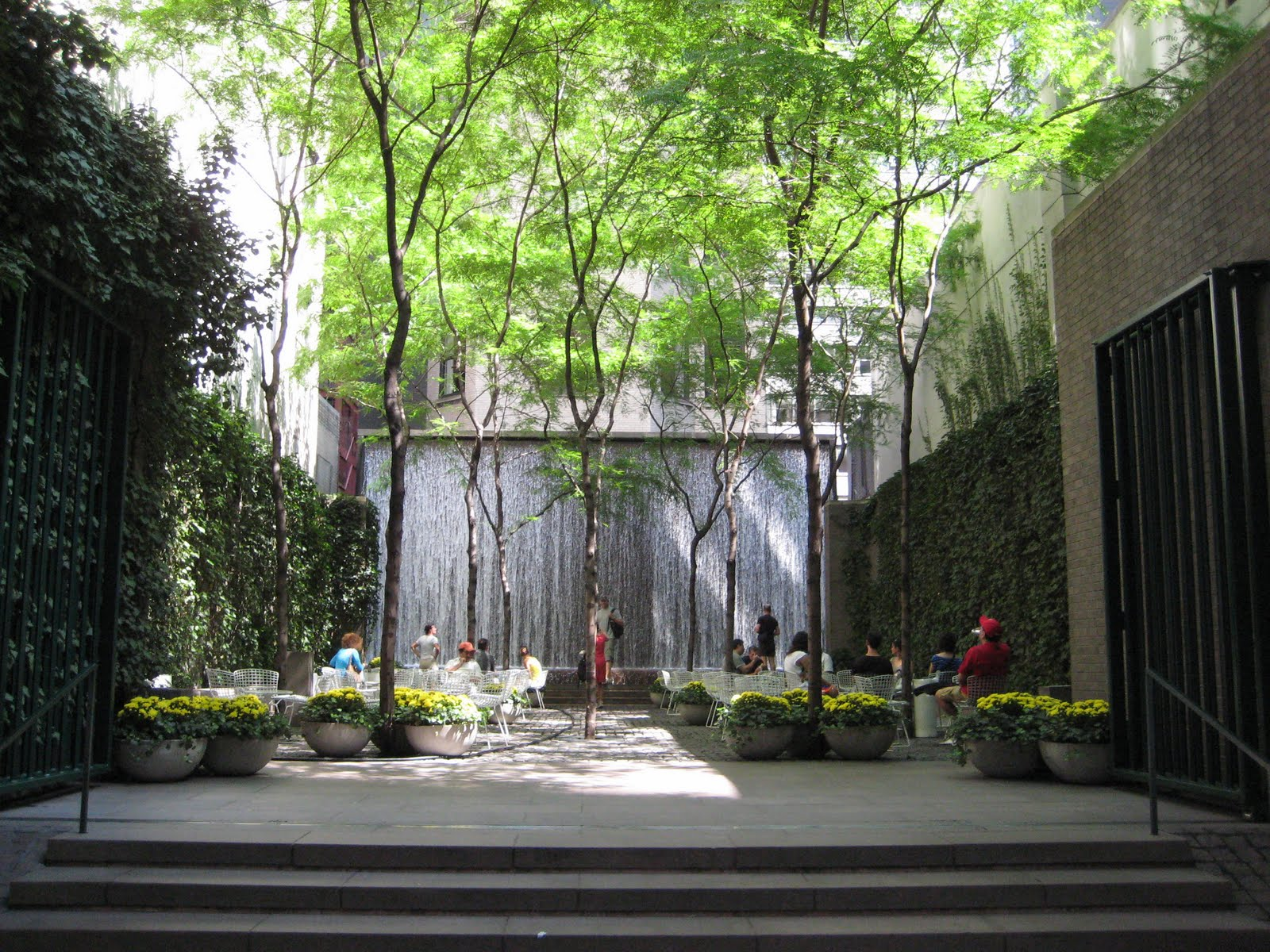 LUSH...Paley Park's waterfall is a relaxing place to read a book