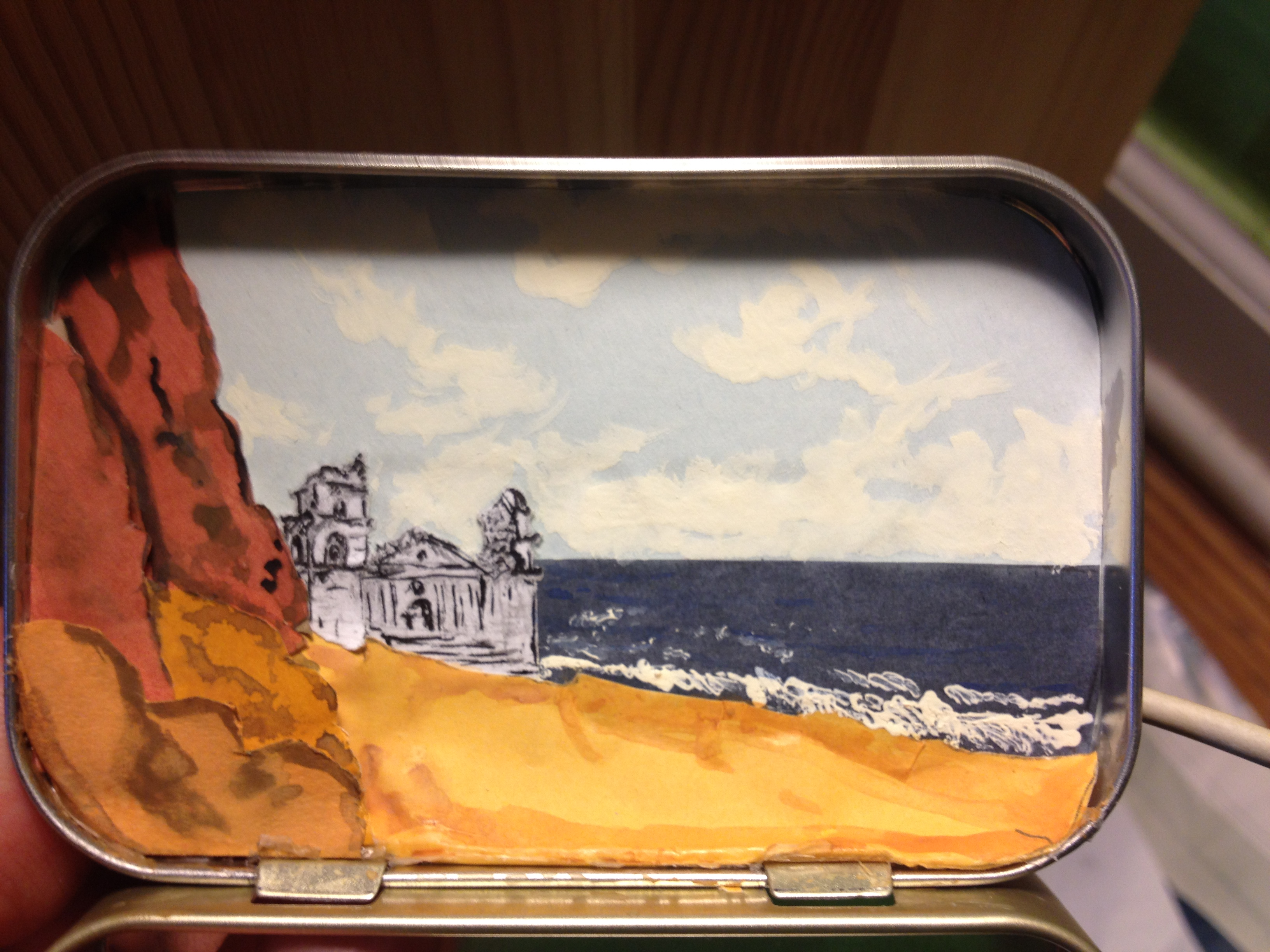 MYSTERIOUS...a palace is lapped by waves on a rocky coast in this dream box