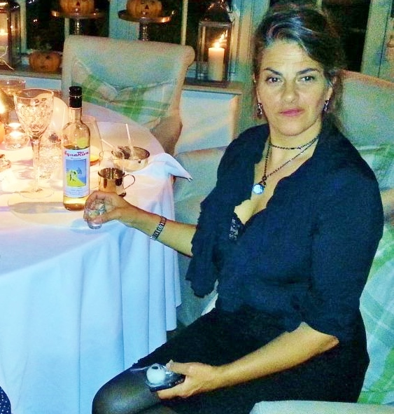 FAN...artist Tracey Emin with Cleo's AquaRiva, whose label was painted by an art student