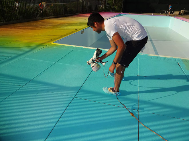 LIFE IN COLOR...Eric Rieger at work painting the rainbow deck