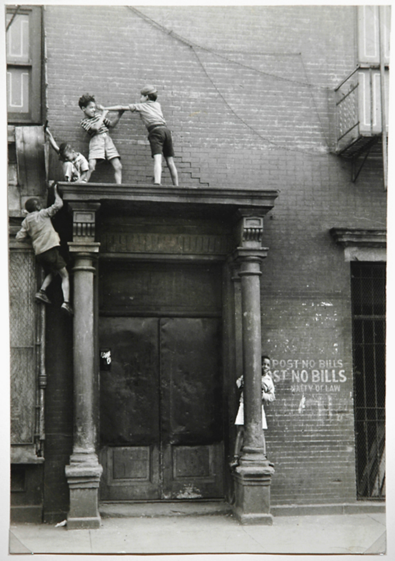 CHILD'S PLAY...Helen Levitt captures kids climbing on to a doorway