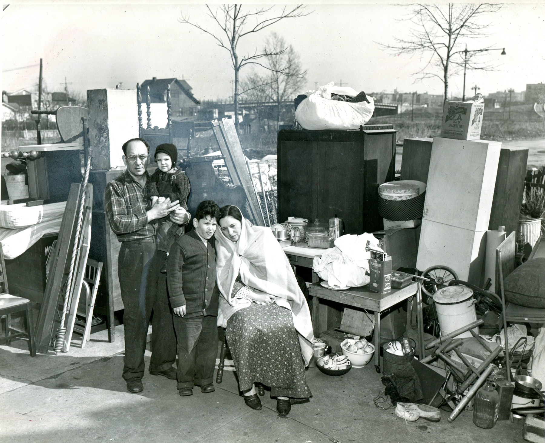 ON THE STREET...Irving Haberman's shot of an evicted family
