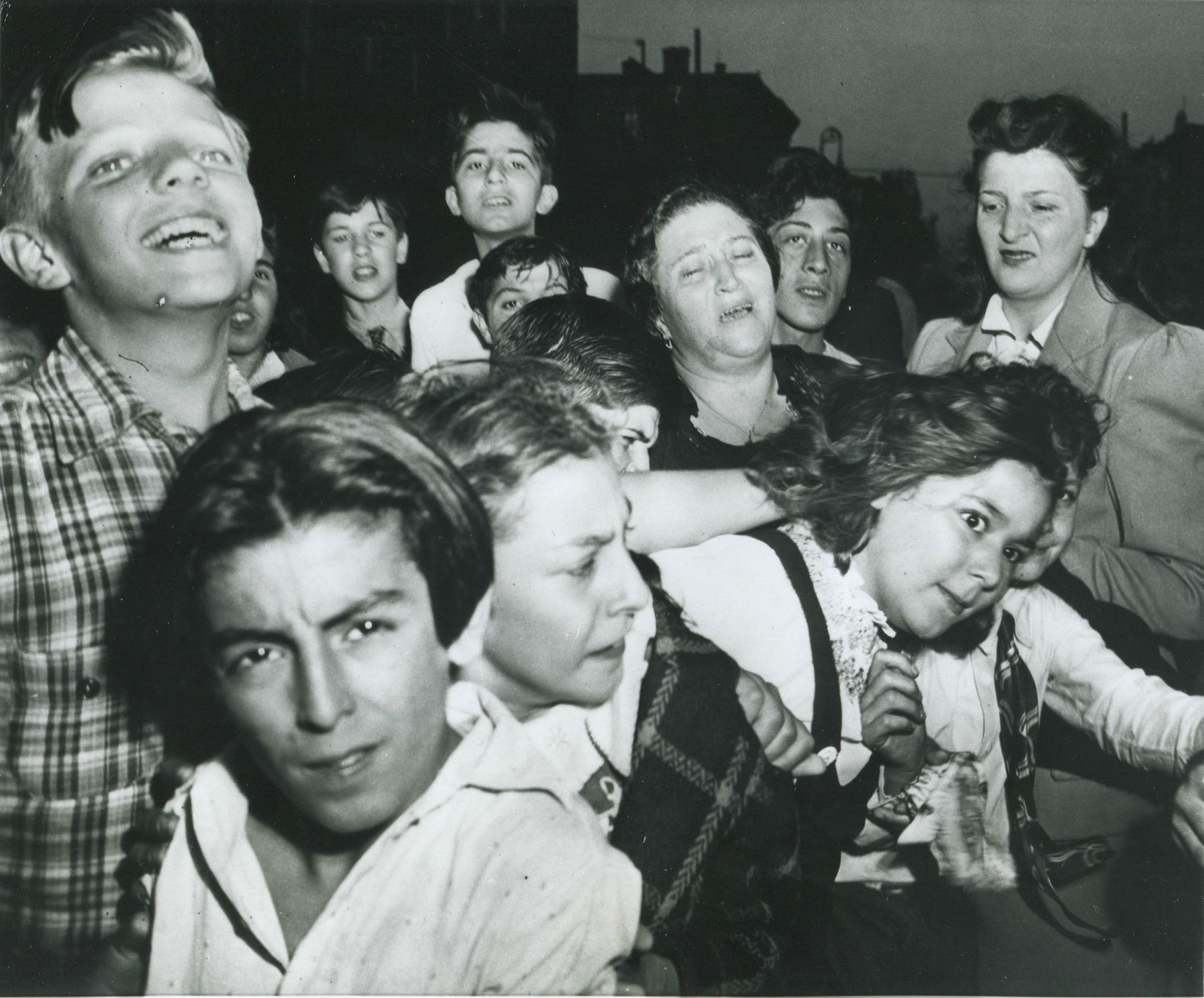 ONLOOKERS...Weegee's photo titled 'Their First Murder'