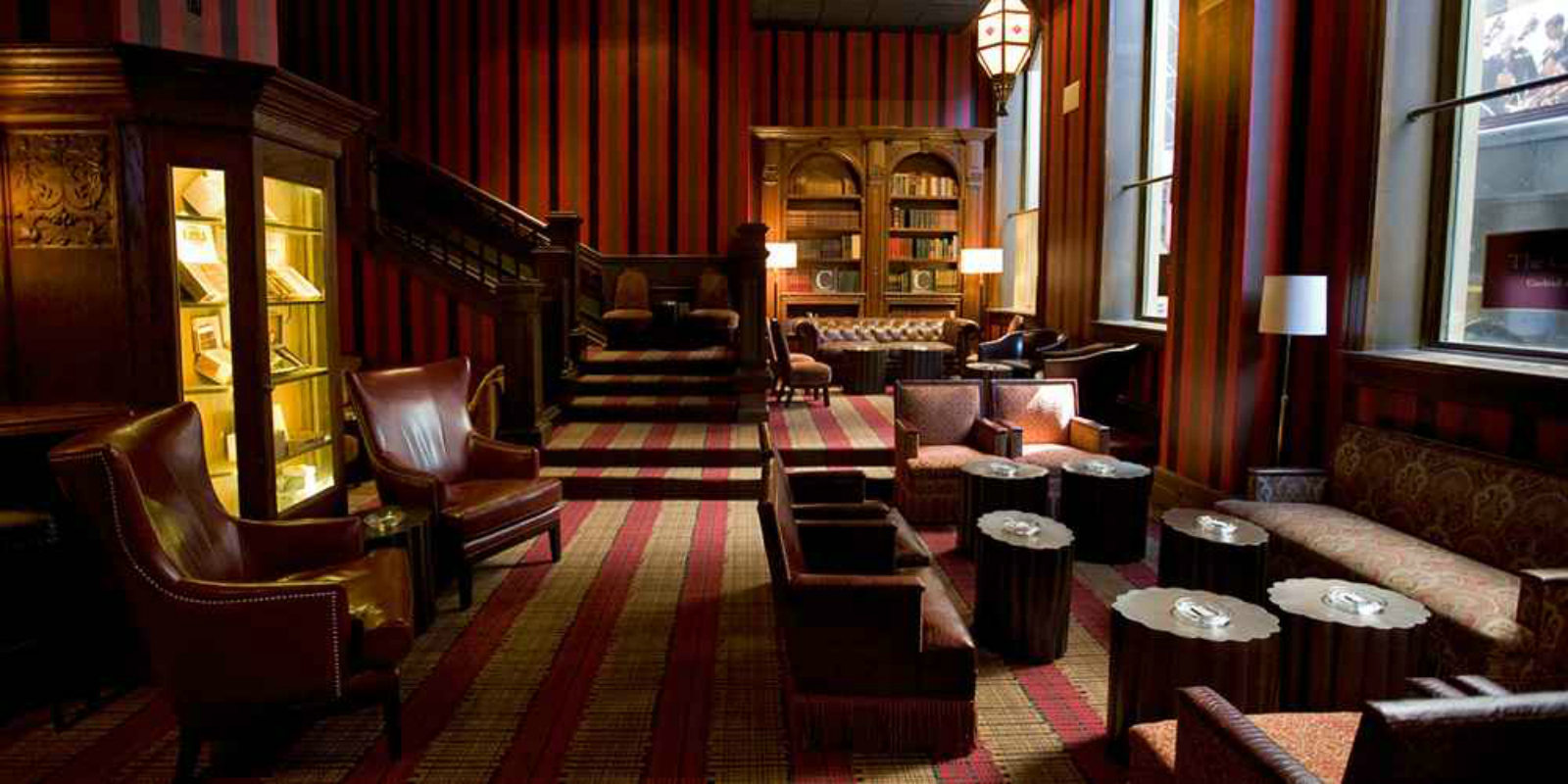DIFFERENT STRIPE...Carnegie Club has cigars - and a roaring fire