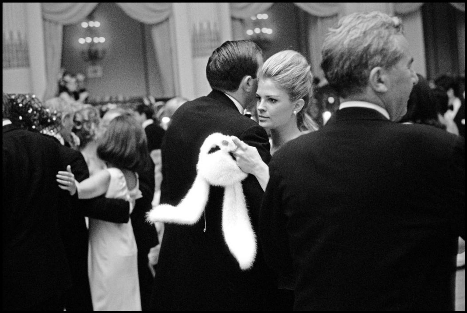 FACE-OFF...Candice Bergen takes a break from the mask at Capote's ball