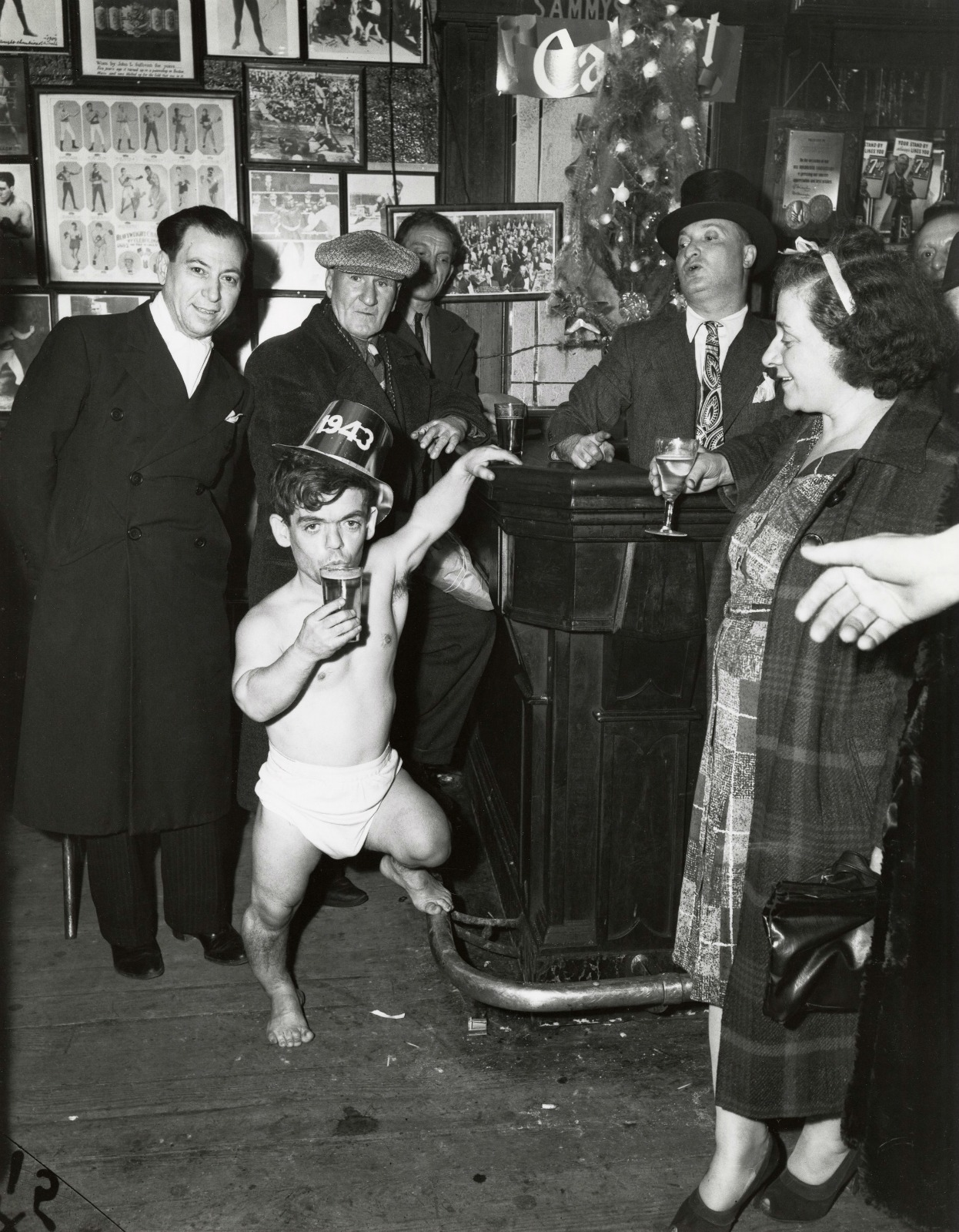 Shorty, the Bowery Cherub, New Year's Eve at Sammy's Bar, New York, 1943, © Weegee / ICP
